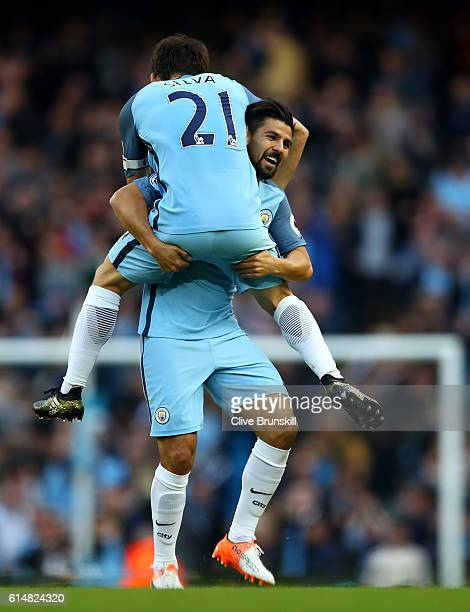 Nolito of Manchester City celebrates scoring his sides first goal with his team mate David Silva of Manchester City during the Premier League match...