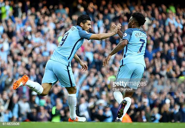 Nolito of Manchester City celebrates scoring the equalising goal with Raheem Sterling during the Premier League match between Manchester City and...
