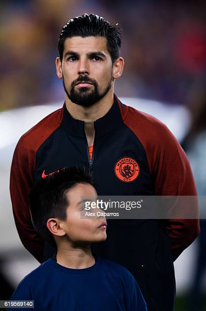 Nolito of Manchester City FC and a player escort look on before the UEFA Champions League group C match between FC Barcelona and Manchester City FC...