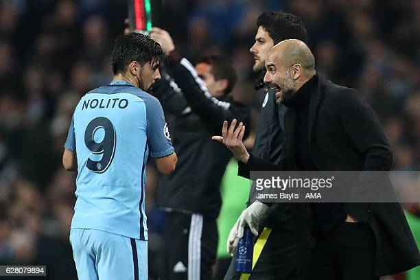Nolito of Manchester City is spoken to by his Head Coach /Manager Pep Guardiola during the UEFA Champions League match between Manchester City FC and...