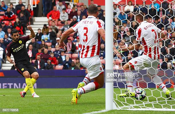 Nolito of Manchester City scores his sides third goal during the Premier League match between Stoke City and Manchester City at Bet365 Stadium on...