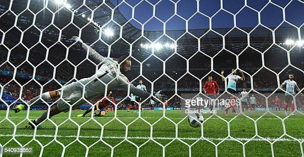 Nolito of Spain scores his sides second goal past Volkan Babacan of Turkey during the UEFA EURO 2016 Group D match between Spain and Turkey at...
