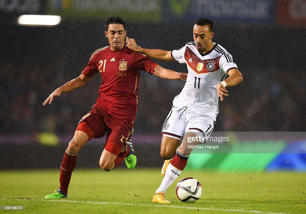 Nolito of Spain vies with Karim Bellarabi of Germany during the International Friendly match between Spain and Germany at Estadio Balaidos on...
