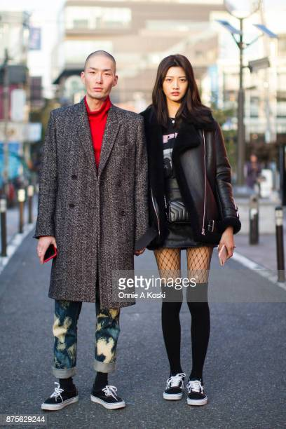 Noma Han and IHua Wu stop for a fashion snap in Harajuku Noma Han is wearing a Public School double breasted herringbone grey coat Gucci acidwashed...