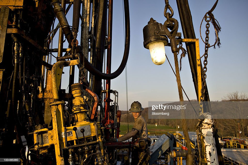 Nomac Drilling Corp. floorhand Chad Glover works on a natural gas drill rig at a Chesapeake Energy Corp. site in Bradford County, Pennsylvania, U.S., on Tuesday, April 6, 2010. Companies are spending billions to dislodge natural gas from a band of shale-sedimentary rock called the Marcellus shale that underlies Pennsylvania, West Virginia and New York. The band of rock, so designated because it pokes through near a city of that name in northern New York, may contain 262 trillion cubic feet of recoverable gas, the U.S. Department of Energy estimates. Photographer: Daniel Acker/Bloomberg via Getty Images