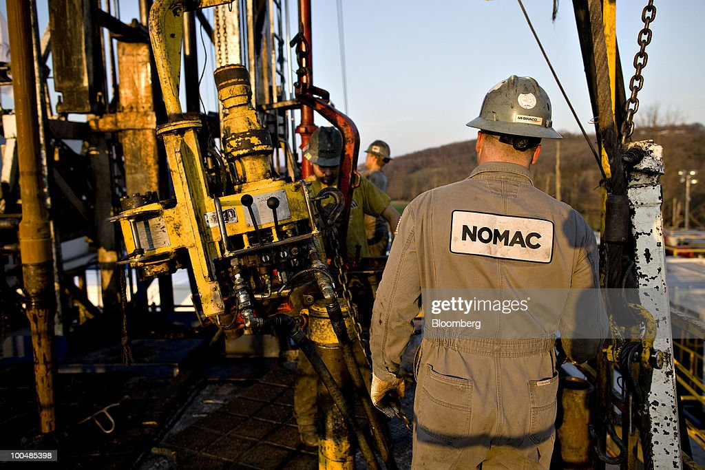 A Nomac Drilling Corp. logo appears on the back of motorman William Henry during natural gas drilling operations at a Chesapeake Energy Corp. site in Bradford County, Pennsylvania, U.S., on Tuesday, April 6, 2010. Companies are spending billions to dislodge natural gas from a band of shale-sedimentary rock called the Marcellus shale that underlies Pennsylvania, West Virginia and New York. The band of rock, so designated because it pokes through near a city of that name in northern New York, may contain 262 trillion cubic feet of recoverable gas, the U.S. Department of Energy estimates. Photographer: Daniel Acker/Bloomberg via Getty Images