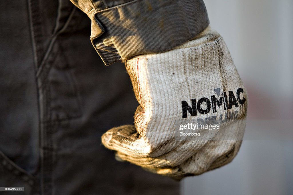 A Nomac Drilling Corp. logo is displayed on the glove of motorman William Henry during natural gas drilling operations at a Chesapeake Energy Corp. site in Bradford County, Pennsylvania, U.S., on Tuesday, April 6, 2010. Companies are spending billions to dislodge natural gas from a band of shale-sedimentary rock called the Marcellus shale that underlies Pennsylvania, West Virginia and New York. The band of rock, so designated because it pokes through near a city of that name in northern New York, may contain 262 trillion cubic feet of recoverable gas, the U.S. Department of Energy estimates. Photographer: Daniel Acker/Bloomberg via Getty Images