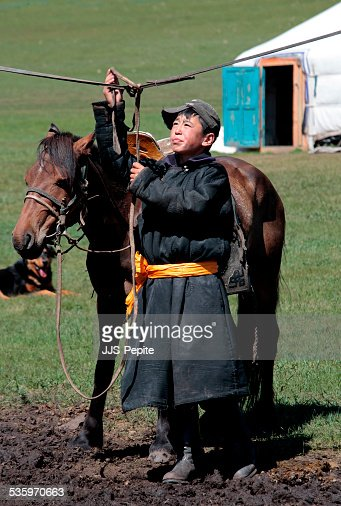 Nomad and his horse, Tsenger Hotwater Springs,  Mongolia : Stock Photo
