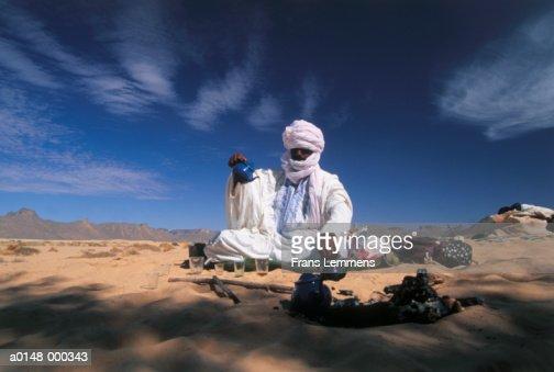 Nomad Making Tea in Desert
