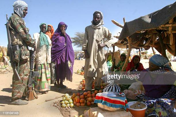 Nomadic Arabs and armed Arab militia men trade and sell in a new market recently established in Aramba North Darfur December 12 2004 Nomadic Arab...