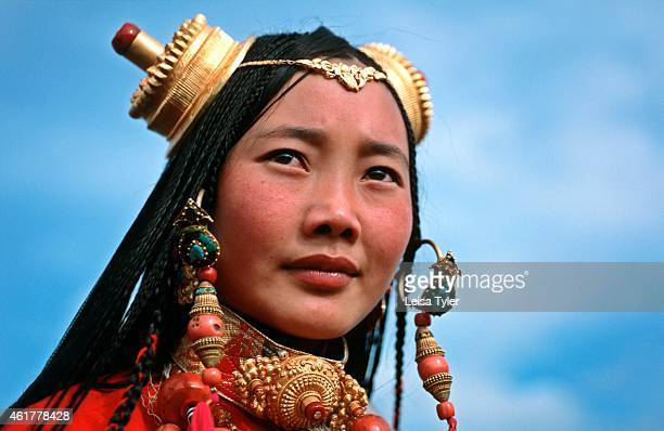 Nomadic Khampa woman wearing exotic headwear at a festival in Sichuan China