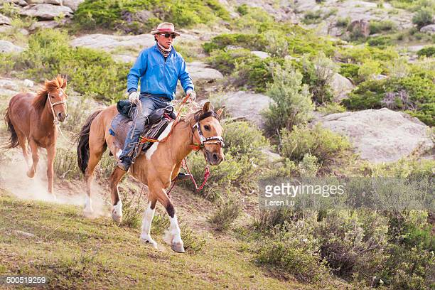 Nomadic young man riding horse