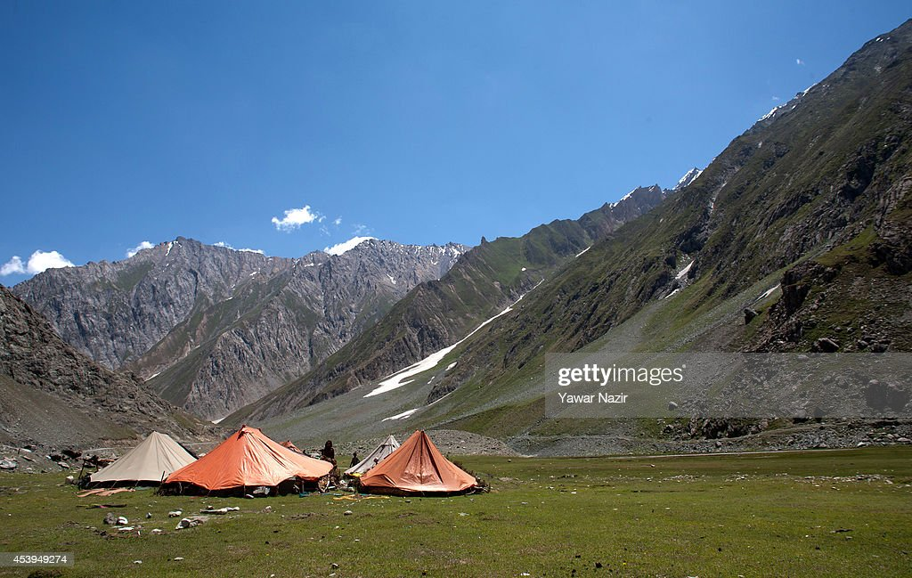 Nomads rest in tents along Srinagar-Leh highway near a treacherous pass on August 22, 2014 in Zojila, about 108 km (67 miles) east of Zojila, has an impressive location, enclosed by Kashmir valley on one side and Drass valley on the other side and functions as a major link between Ladakh and Kashmir, is considered to be the World's most dangerous pass is located at 3529 meters. The average snow buildup on the rocky Zojila- which is part of the 443 km (275 miles) long Srinagar-Leh highway- normally stays in the level of 15 to 25 meters and is closed for half year. It opens up in late spring and witnesses violent breezes because of the conical shape. Travellers on the pass have to face and withstand snowstorms, fierce air currents, cold and highly dangerous circumstances.