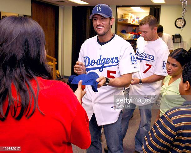Nomar Garciaparra and JD Drew of the Los Angeles Dodgers signs autographs during a visit to the White Memorial Medical Center Pediatric Unit in Los...