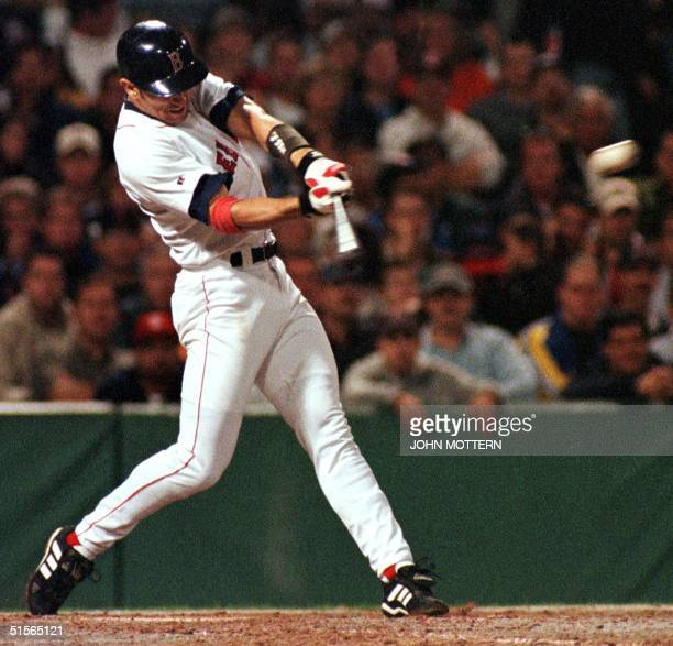 Nomar Garciaparra of the Boston Red Sox hits a two run tripple in the 3rd inning against the Cleveland Indians 19 September 2000 at Fenway Park in...