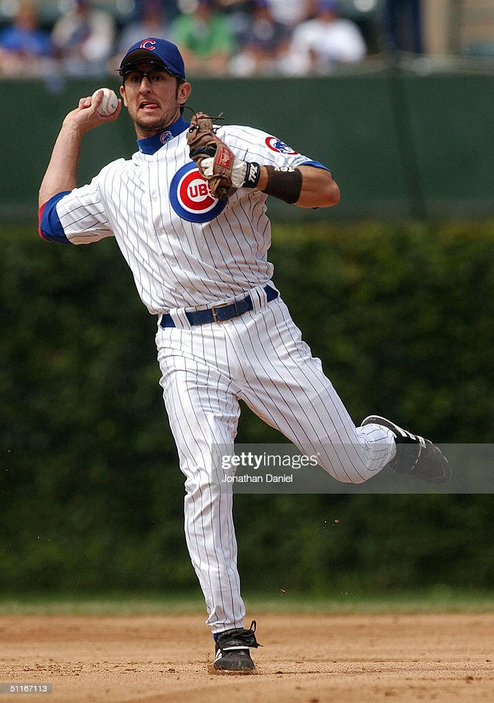 Nomar Garciaparra of the Chicago Cubs throws out Shawn Green of the Los Angeles Dodgers in the second inning on August 13 2004 at Wrigley Field in...