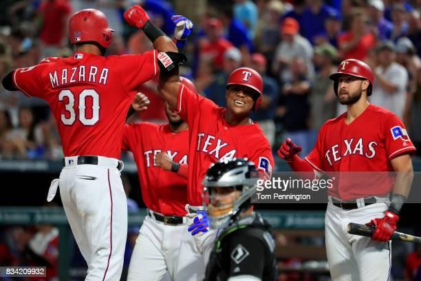 Nomar Mazara of the Texas Rangers celebrates with Elvis Andrus of the Texas Rangers Adrian Beltre of the Texas Rangers and Joey Gallo of the Texas...