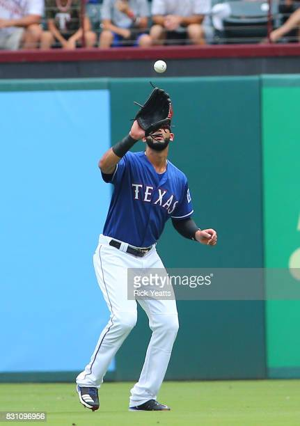 Nomar Mazara of the Texas Rangers fields a fly ball in the first inning against the Houston Astros at Globe Life Park in Arlington on August 13 2017...