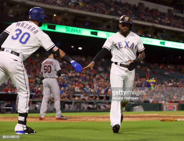 Nomar Mazara of the Texas Rangers greets Delino DeShields of the Texas Rangers who scored in the first inning against the Houston Astros at Globe...