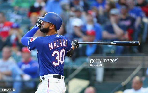 Nomar Mazara of the Texas Rangers hits a home run in the first inning against the Cleveland Indians at Globe Life Park in Arlington on April 5 2017...