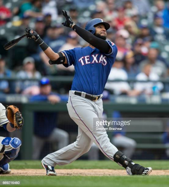 Nomar Mazara of the Texas Rangers hits a solo home run off of relieft pitcher Edwin Diaz of the Seattle Mariners during the ninth inning of a game at...