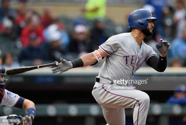Nomar Mazara of the Texas Rangers hits an RBI single against the Minnesota Twins during the first inning of the game on August 3 2017 at Target Field...