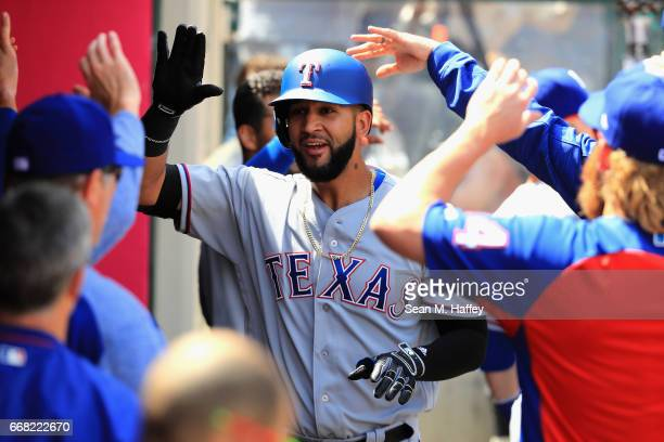Nomar Mazara of the Texas Rangers is congratulated in the dugout after hitting a tworun homerun during the third inning of a game against the Los...