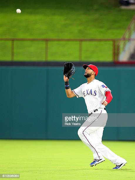 Nomar Mazara of the Texas Rangers makes a running catch in the first inning against the Milwaukee Brewers at Globe Life Park in Arlington on...