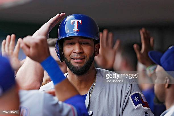 Nomar Mazara of the Texas Rangers receives congratulations in the dugout after hitting a threerun home run in the second inning against the...