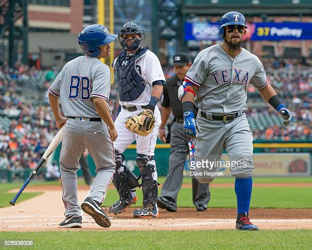 Nomar Mazara of the Texas Rangers rounds the bases after hitting a first inning home run during a MLB game against the Detroit Tigers at Comerica...