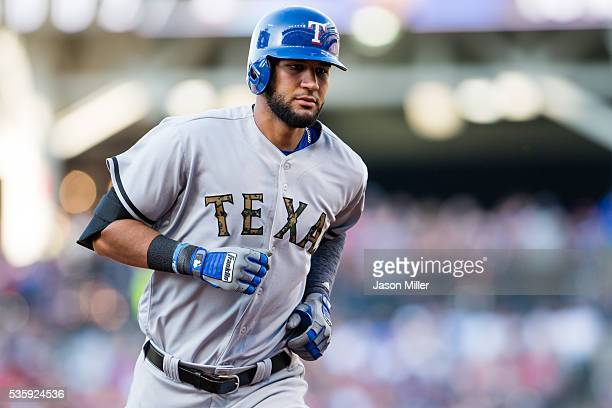 Nomar Mazara of the Texas Rangers rounds the bases after hitting a three run home run off relief pitcher Austin Adams of the Cleveland Indians during...