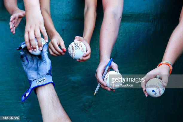 Nomar Mazara of the Texas Rangers signs autographs for fans before the game against the Kansas City Royals at Kauffman Stadium on July 15 2017 in...