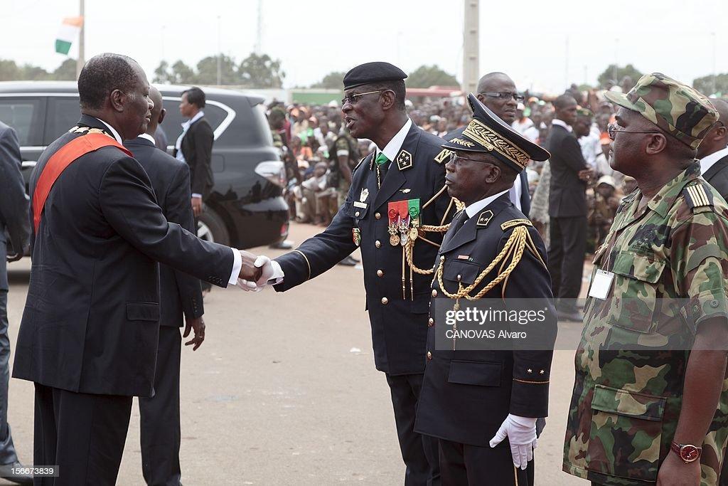 Nomination Of <a gi-track='captionPersonalityLinkClicked' href=/galleries/search?phrase=Alassane+Ouattara&family=editorial&specificpeople=697562 ng-click='$event.stopPropagation()'>Alassane Ouattara</a>. Samedi 21 mai, Alassane OUATTARA a été investi chef de l'Etat ivoirien à YAMOUSSOUKRO, la ville natale du 'père de la nation', Félix HOUPHOUET-BOIGNY : juste après la cérémonie, le nouveau président ivoirien serre la main de Philippe MANGOU, un général de Laurent Gbagbo qui a changé de camp peu avant l'arrestation de ce dernier. Au premier plan, son adversaire d'hier, Soumaïla BAKAYOKO, l'ancien chef d'état-major des forces rebelles.
