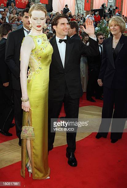 Nominee for Best Actor Tom Cruise accompanied by his wife Nicole Kidman waves to fans as he arrives at the Shrine Auditorium in Los Angeles 24 March...