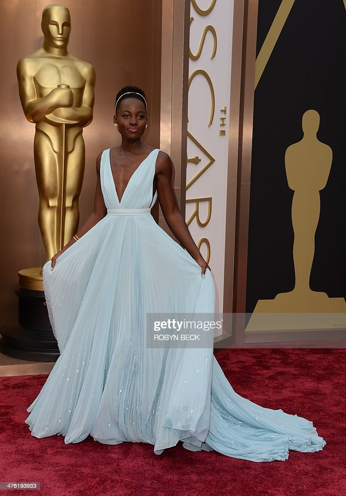 Nominee for Best Supporting Actress in '12 Years a Slave' Lupita Nyong'o arrives on the red carpet for the 86th Academy Awards on March 2nd 2014 in...