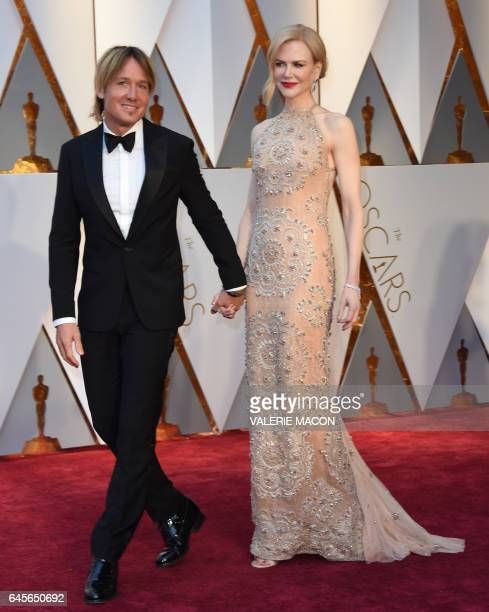 Nominee for Best Supporting Actress 'Lion' Nicole Kidman and Australian singer Keith Urban arrive on the red carpet for the 89th Oscars on February...