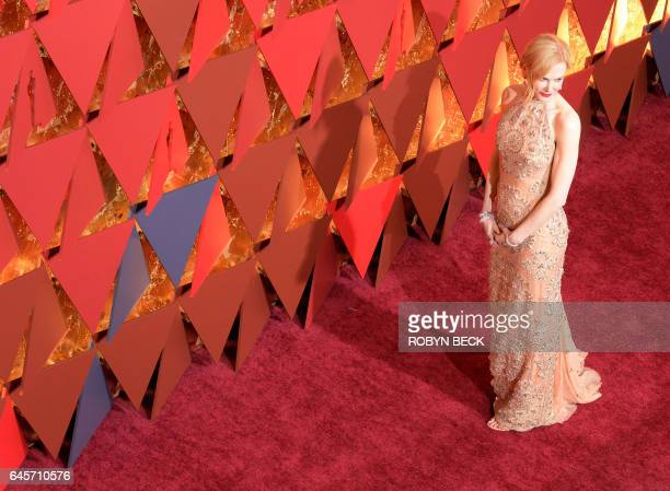 Nominee for Best Supporting Actress 'Lion' Nicole Kidman poses as he arrives on the red carpet for the 89th Oscars on February 26 2017 in Hollywood...
