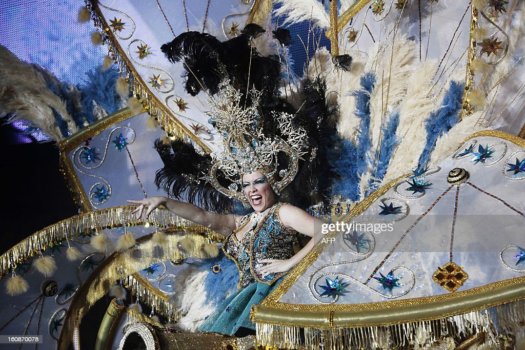 A nominee for Queen of the 2013 Santa Cruz carnival performs in Santa Cruz de Tenerife on the Spanish Canary island of Tenerife on February 6, 2013. AFP PHOTO / DESIREE MARTIN