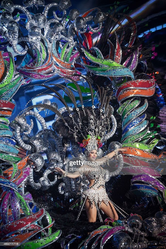 A nominee for Queen of the Carnival of Santa Cruz shows off her outfit on the main stage in Santa Cruz de Tenerife on the Spanish Canary island of...