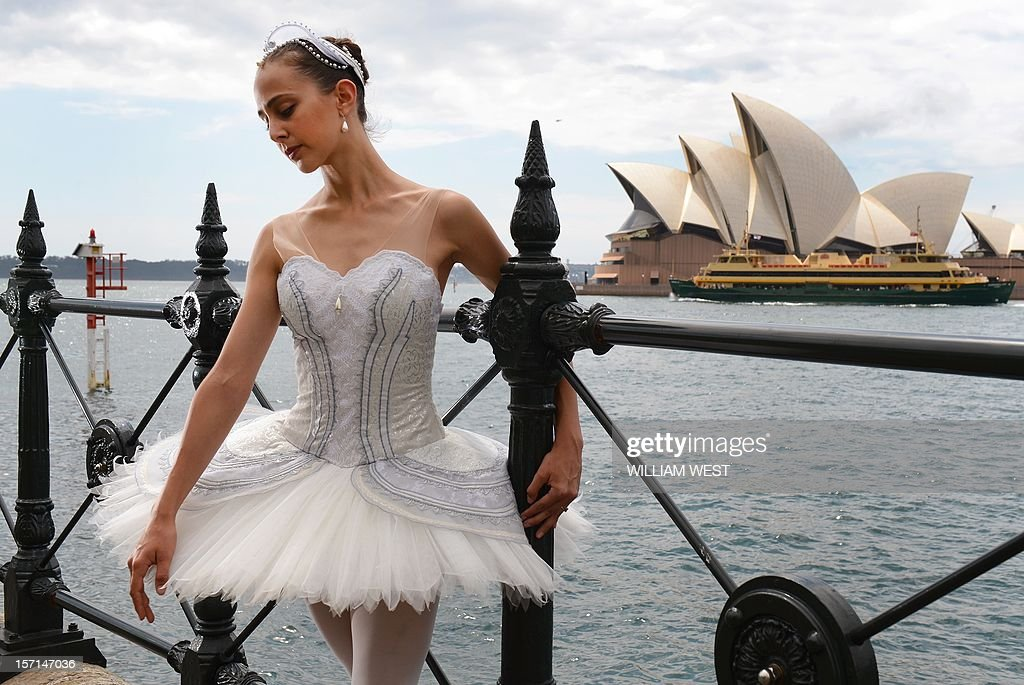 Nominee for the Australian Ballet Dancer Award, Dimity Azoury poses in front of the Sydney Opera House as she and the other nominees enter the final 24 hours of competition with the winner to be announced onstage after the Sydney premiere of Stephen Baynes' Swan Lake, in Sydney on November 29, 2012. Following a year of performances on stages across Australia, the judges' decisions will be tallied and the 2012 winner will take home the 20,000 Australian dollar (20,926 US) first prize. AFP PHOTO/William WEST