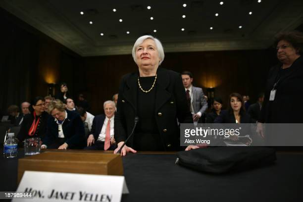 Nominee for the Federal Reserve Board Chairman Janet Yellen leaves after her confirmation hearing November 14 2013 on Capitol Hill in Washington DC...
