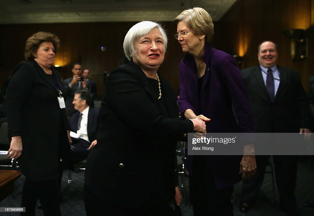 Nominee for the Federal Reserve Board Chairman <a gi-track='captionPersonalityLinkClicked' href=/galleries/search?phrase=Janet+Yellen&family=editorial&specificpeople=2731344 ng-click='$event.stopPropagation()'>Janet Yellen</a> (L) shakes hands with Sen. Elizabeth Warren (D-MA) (R) after her confirmation hearing before Senate Banking, Housing and Urban Affairs Committee November 14, 2013 on Capitol Hill in Washington, DC. Yellen will be the first woman to head the Federal Reserve if confirmed by the Senate and will succeed Ben Bernanke.