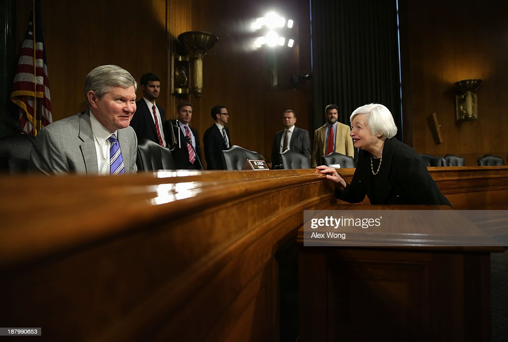 Nominee for the Federal Reserve Board Chairman <a gi-track='captionPersonalityLinkClicked' href=/galleries/search?phrase=Janet+Yellen&family=editorial&specificpeople=2731344 ng-click='$event.stopPropagation()'>Janet Yellen</a> (R) talks to committee chairman Sen. Tim Johnson (D-SD) (L) after her confirmation hearing before Senate Banking, Housing and Urban Affairs Committee November 14, 2013 on Capitol Hill in Washington, DC. Yellen will be the first woman to head the Federal Reserve if confirmed by the Senate and will succeed Ben Bernanke.