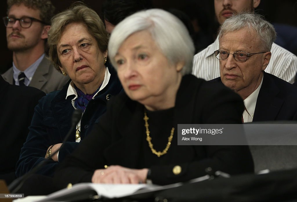 Nominee for the Federal Reserve Board Chairman <a gi-track='captionPersonalityLinkClicked' href=/galleries/search?phrase=Janet+Yellen&family=editorial&specificpeople=2731344 ng-click='$event.stopPropagation()'>Janet Yellen</a> (3rd L) testifies during her confirmation hearing before Senate Banking, Housing and Urban Affairs Committee as her husband and 2001 Nobel Prize in Economics recipient <a gi-track='captionPersonalityLinkClicked' href=/galleries/search?phrase=George+Akerlof&family=editorial&specificpeople=2684768 ng-click='$event.stopPropagation()'>George Akerlof</a> (R) and her sister-in-law Alison Brooks (2nd L) listen November 14, 2013 on Capitol Hill in Washington, DC. Yellen will be the first woman to head the Federal Reserve if confirmed by the Senate and will succeed Ben Bernanke.