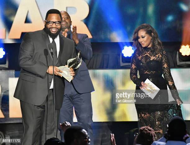Nominee Hezekiah Walker accepts the award for 'Choir of the Year' as Myron Butler and Adrienne Houghton stand onstage during the 32nd annual Stellar...