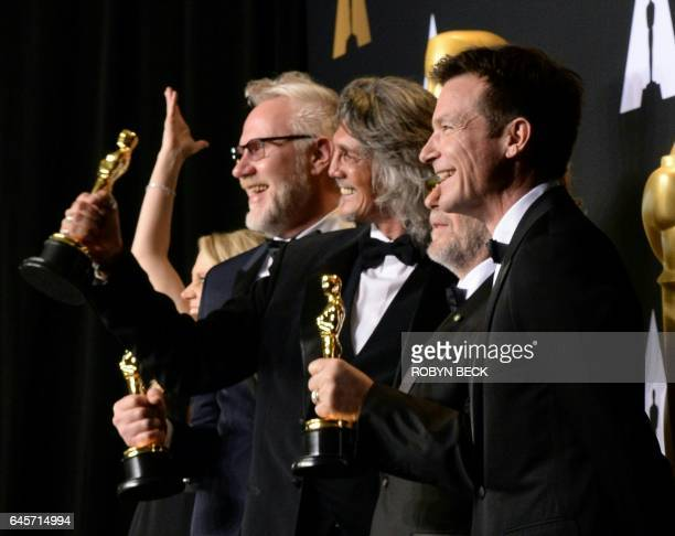Nominees for Best MakeUp and Hairstyling 'Suicide Squad' Alessandro Bertolazzi Giorgio Gregorini and Christopher Nelson pose with the Oscar in the...