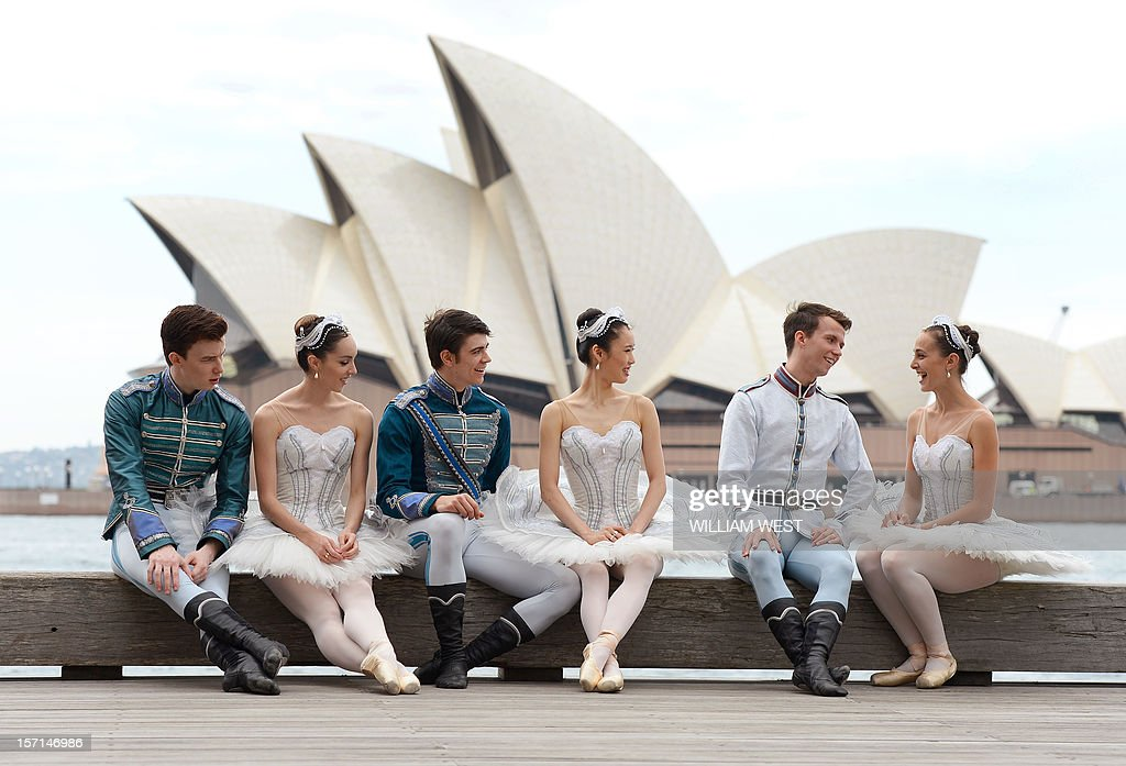 Nominees for the Australian Ballet Dancer Award, Jarryd Madden (L), Amy Harris (2/L), Jake Mangakahia (3/L), Ako Kondo (3/R), Calvin Hannaford (2/R) and Dimity Azoury (R) relax after a photo shoot in front of the Sydney Opera House as they enter the final 24 hours of competition with the winner to be announced onstage after the Sydney premiere of Stephen Baynes' Swan Lake, in Sydney on November 29, 2012. Following a year of performances on stages across Australia, the judges' decisions will be tallied and the 2012 winner will take home the 20,000 Australian dollar (20,926 US) first prize. AFP PHOTO/William WEST