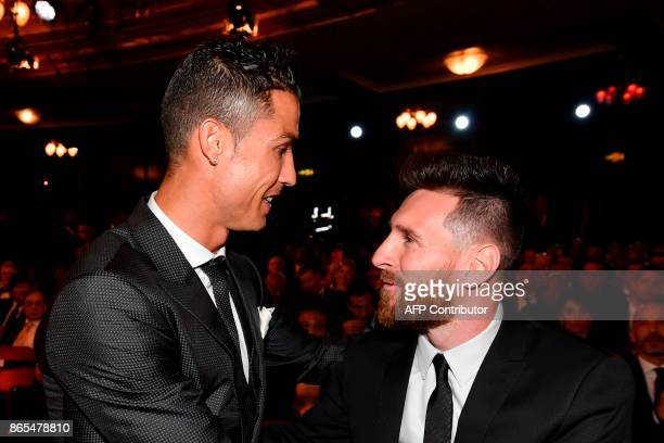 Nominees for the Best FIFA football player Barcelona and Argentina forward Lionel Messi and Real Madrid and Portugal forward Cristiano Ronaldo chat...