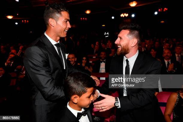 TOPSHOT Nominees for the Best FIFA football player Barcelona and Argentina forward Lionel Messi and Real Madrid and Portugal forward Cristiano...