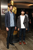 Nominees Julien Feret and HU Wei attend the 87th Annual Academy Awards Oscar Week Celebrates Shorts at Samuel Goldwyn Theater on February 17 2015 in...